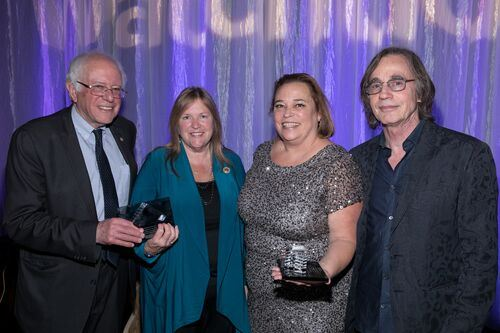 Chris Spagnoli with Bernie and Jane Sanders and musician Jackson Browne.