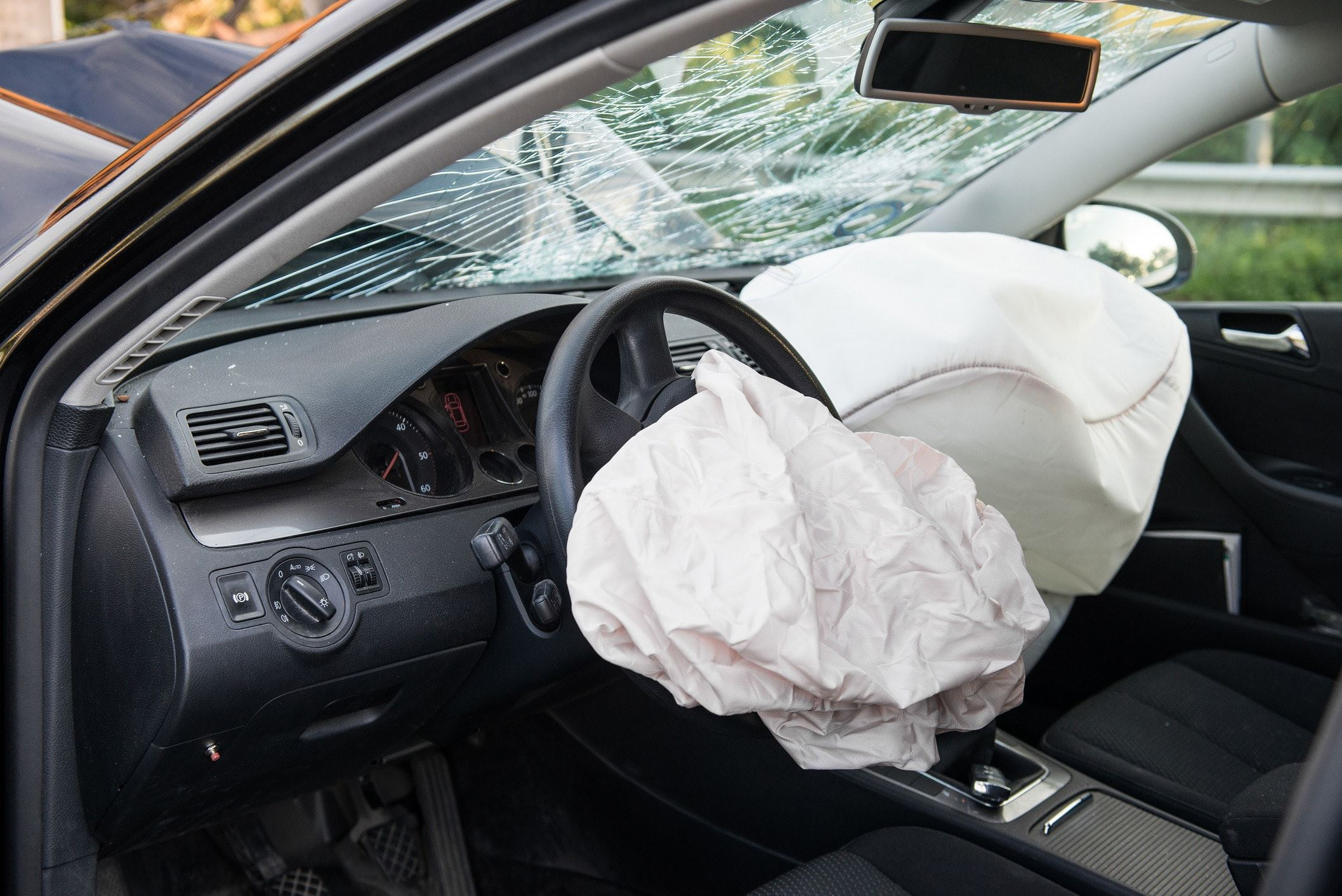 Cracked windshield and deployed airbag