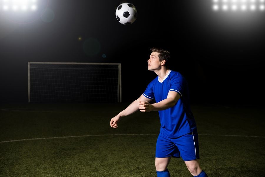 Soccer playing bouncing ball on head